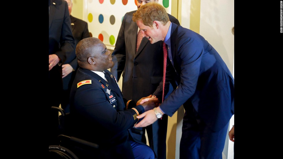 U.S. Army Col. Gregory Gadson greets Harry before the reception and dinner at the British ambassador's residence.