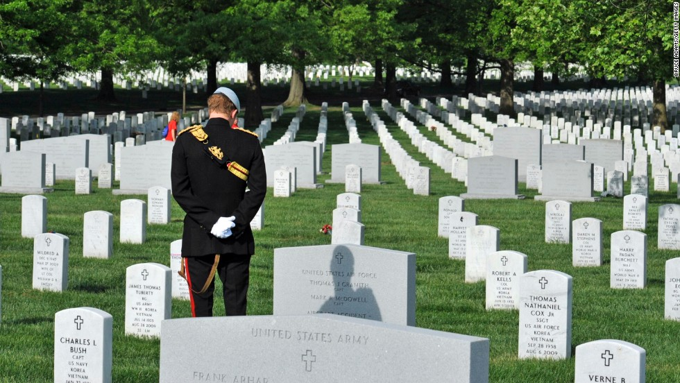 Prince Harry pays his respects during his visit to Arlington National Cemetery.