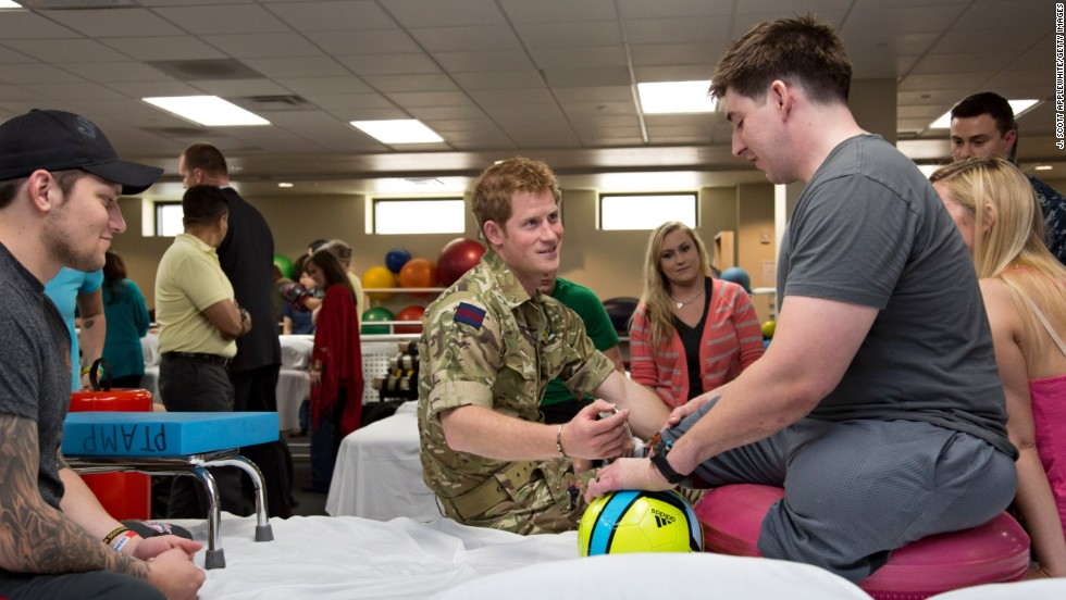 Prince Harry speaks with Staff Sgt. Timothy Payne, who lost his legs in an IED explosion in Afghanistan, during his visit to the Military Advanced Training Center at Walter Reed National Military Medical Center on May 10 in Bethesda, Maryland.