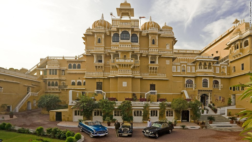 The brightly colored exterior of the Deogarh Mahal hotel in the state of Rajasthan. Once home to some of the most powerful feudal barons in the region, the rural residence is now a popular stop-off for well-to-do tourists.