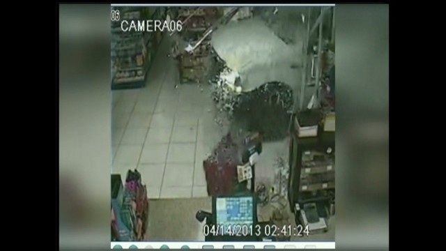 Thieves drive through store, steal ATM