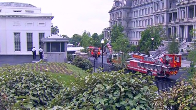 Fire trucks pull up on the White House grounds Saturday, after there were reports of smoke.
