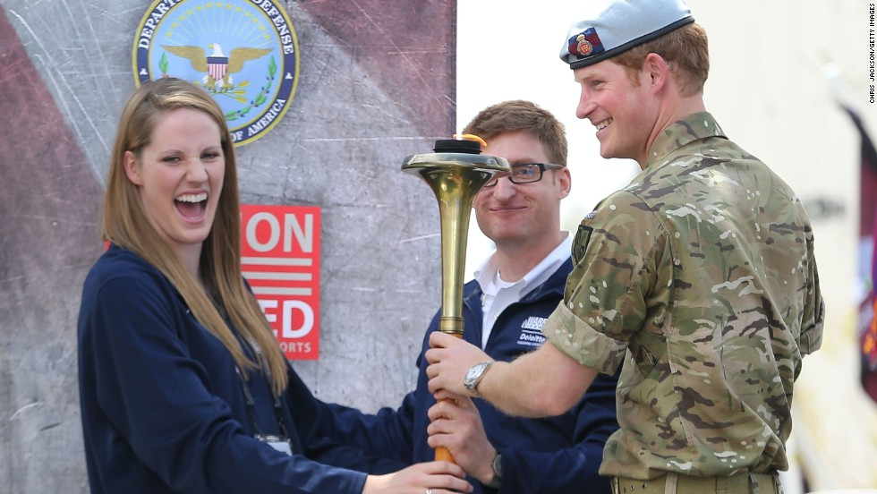 Prince Harry holds the torch used to light the cauldron at the Warrior Games with Olympian Missy Franklin and U.S. Paralympian Lt. Brad Snyder on May 11.