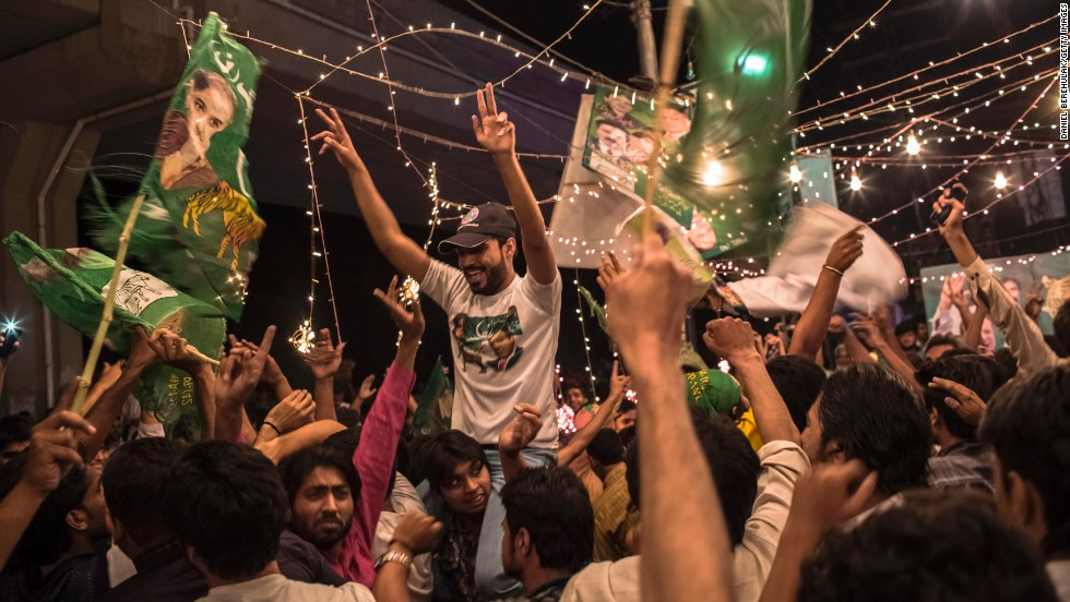 Supporters of Pakistan Muslim League Nawaz, Nawaz Sharif's party, celebrate election results in front of a party office in Lahore on election night, Saturday, May 11.