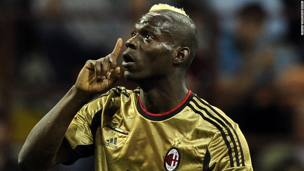 AC Milan's Mario Balotelli reacts to racist abuse from the visiting Roma fans at the San Siro in May 2013. It was not the first time the Italian-born striker has been racially abused in Serie A. Balotelli has since moved clubs and now plays for Liverpool in the Premier League.