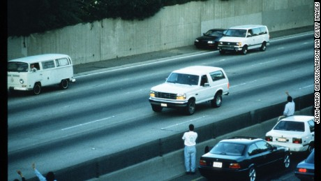 190530 05: Al Cowlings drives football star O.J. Simpson south on LA Highway 405 in a white Ford Bronco followed by police cars June 17, 1994 in Los Angeles, CA. Simpson attempted to flee accusations of murdering his ex-wife and her friend but turned himself in pleading innocence. (Photo by Jean-Marc Giboux/Liaison)