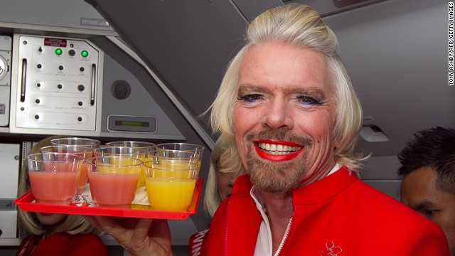 If you want to know how a man with thick facial hair looks like in red lipstick, fake eye lashes and purple eyeliner, this may be your only chance. Richard Branson dressed as AirAsia's flight attendant on Sunday after losing a bet to AirAsia's CEO Tony Fernandes two years ago.