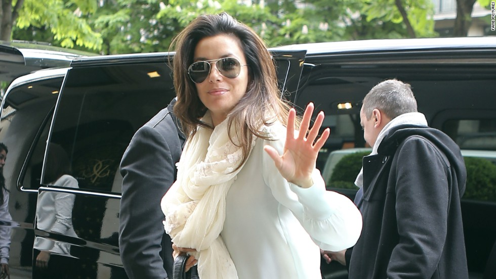 Eva Longoria waves as she arrives in Paris, France on May 11.