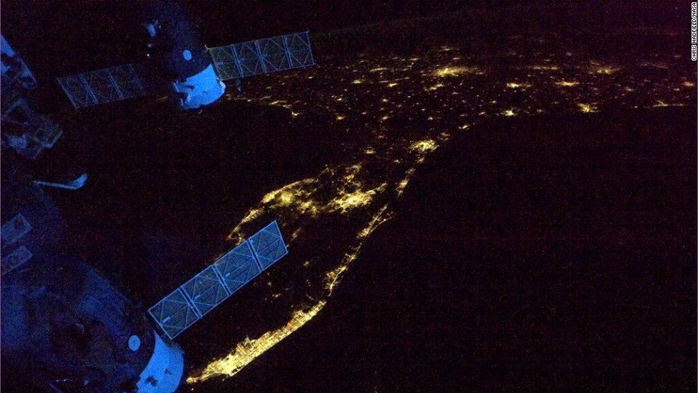 "A view of the <a href=""https://twitter.com/Cmdr_Hadfield/status/333660605984677888"" target=""_blank"">Florida Peninsula</a> at night. ""Spaceship's glowing blue in the dawn,"" wrote Hadfield on May 12, ""as we leave Florida headed across the Atlantic."""