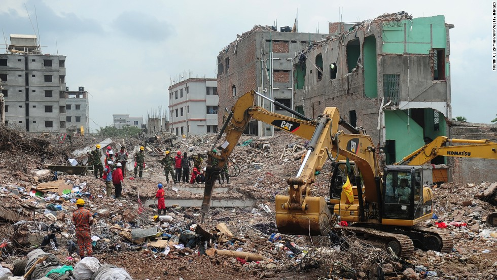 Bangladeshi army workers supervise the  continued rescue operation using heavy equipment to sift through the rubble on May 10 in Dhaka.