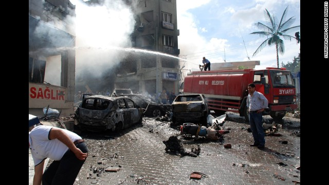 Emergency crews work to put out a fire near the town hall in Reyhanli after a car bomb exploded Saturday, May 11, 2013.