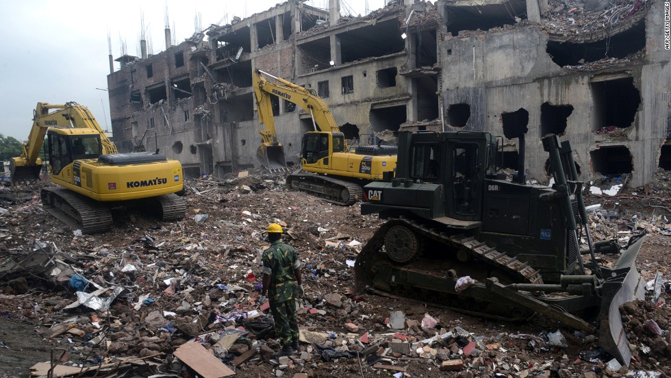 Heavy equipment sifts through the rubble of the garment factory building collapse on Sunday, May 12.