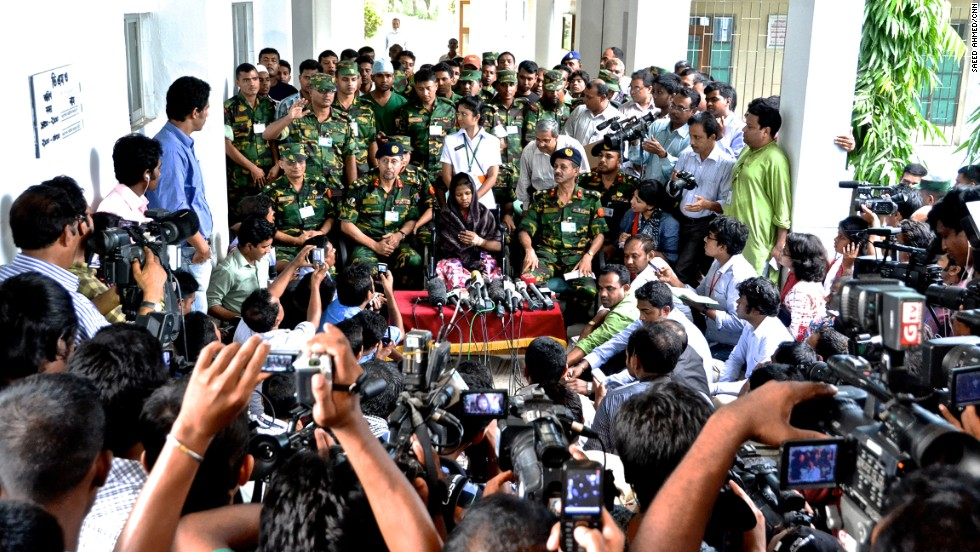 Throngs of reporters crowd around Begum as she speaks publicly for the first time on May 13 about her ordeal in Dhaka.