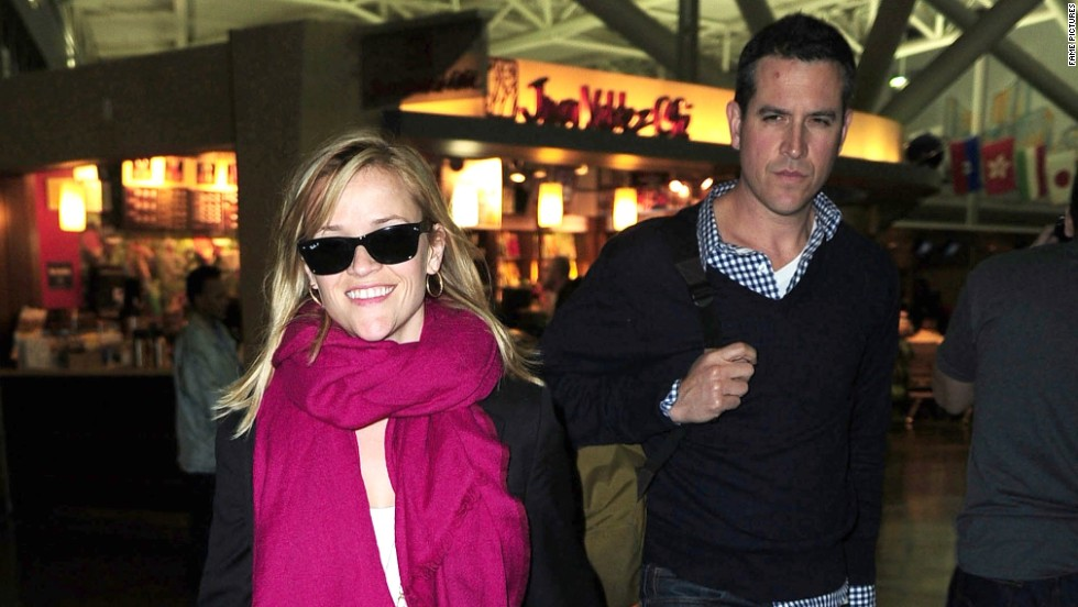 Reese Witherspoon and husband Jim Toth arrive at the airport in New York on May 13.