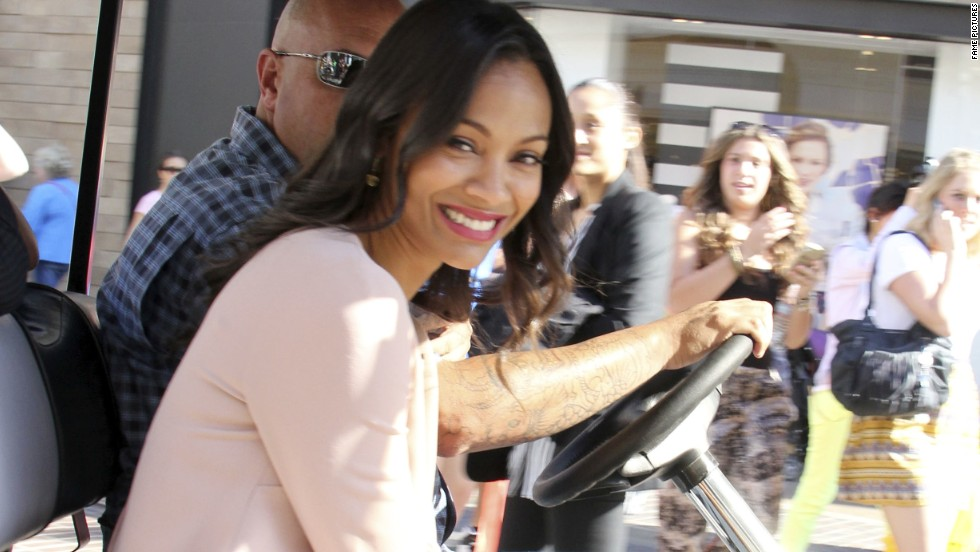 Zoe Saldana catches a ride at The Grove in Los Angeles on May 13.