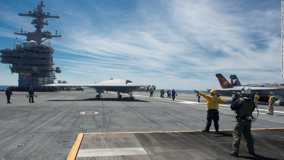 The drone taxis on the flight deck of the aircraft carrier.
