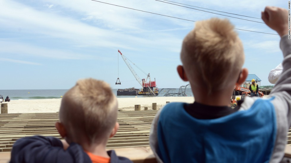 Two boys watch the demolition of the Jet Star.