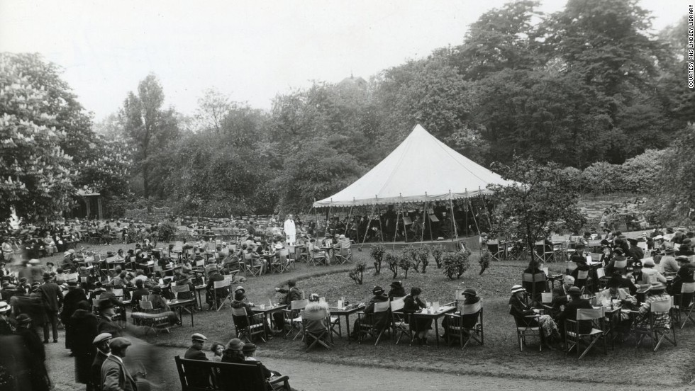Visitors relax to the sound of a band playing in the 1937 Chelsea Flower Show