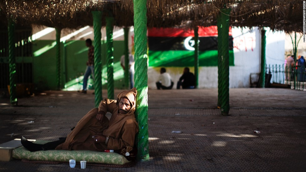 A man relaxes on the patio outside a mosque in Tripoli on October 26, 2011.