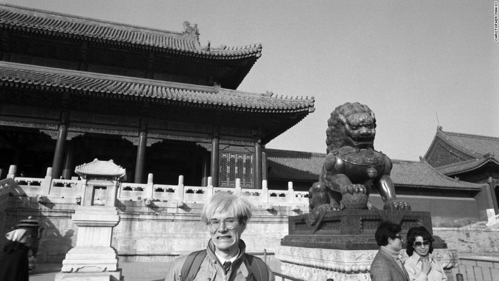 After signing as a model with Ford Agency, Warhol began considering how to pose for the camera.  Warhol experimented with poses in front of his friend and personal photographer, Christopher Makos.  Here, he imitates the expression of one of the guardian lions in Beijing's Forbidden City.