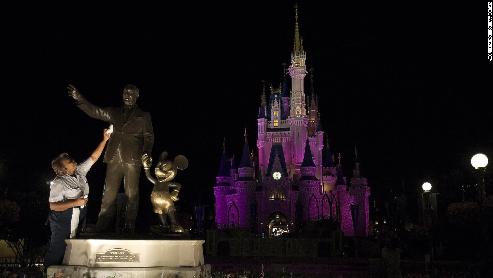 1. It takes many hands to keep the Magic Kingdom in Florida on top as  the No. 1 amusement park in the world. Here a custodian polishes the Walt Disney and Mickey Mouse statue at the Orlando park.