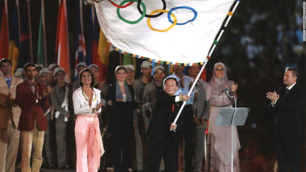 Angelopoulos hands over the Olympic flag to Beijing at the Athens 2004  closing ceremony.