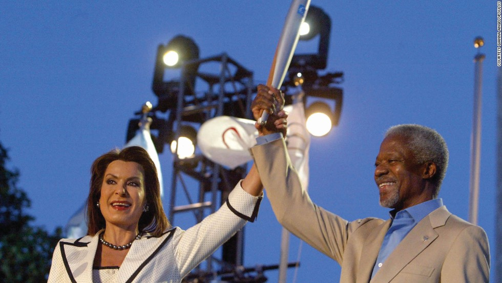 As head of the Athens 2004 Organizing Committee, Angelopoulos lifts the Olympic torch with Kofi Annan, the then Secretary General of the United Nations.