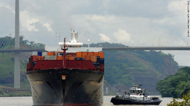 A freight-carrying ship sails under the Centenario bridge at the Pedro Miguel locks entrance on August 15, 2009, in the Panama Canal.