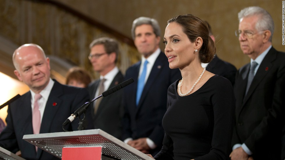 Jolie has become an influential diplomatic personality, meeting with world leaders through her work with the UN. British Foreign Secretary William Hague (L) listens as Jolie speaks on the issue of sexual violence against women during a G8 Foreign Ministers meeting in London on April 11, 2013.