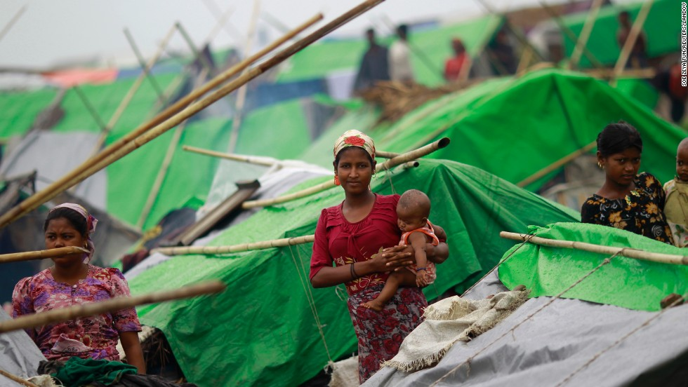 Women pass time in a Rohingya displacement camp outside Sittwe, Myanmar, on May 15. Authorities and relief agencies have been relocating tens of thousands of internally displaced people at camps throughout the low-lying region.