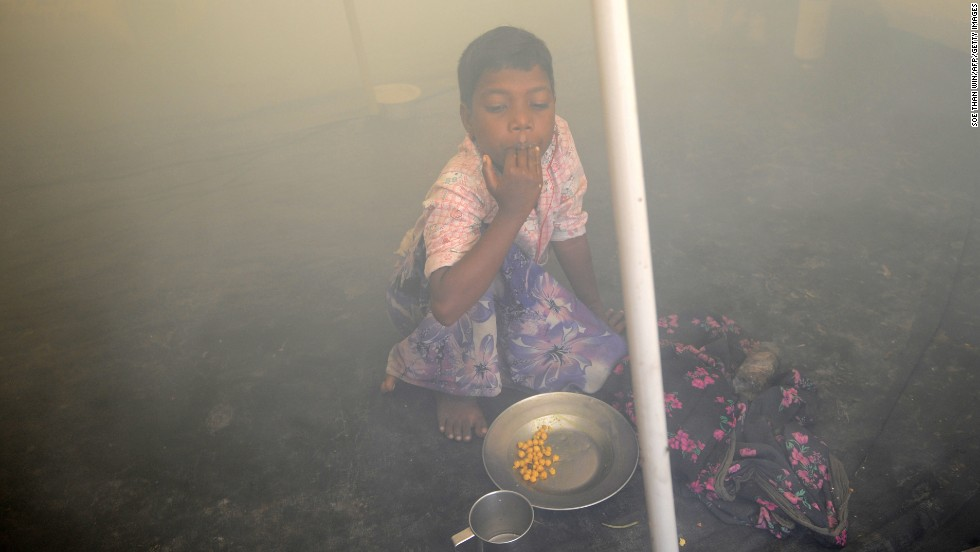 A Rohingya child has breakfast inside a relief tent at the Ohnedaw camp on May 15.