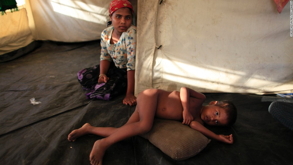 A Muslim family rests in their temporary shelter outside Sittwe on May 15.