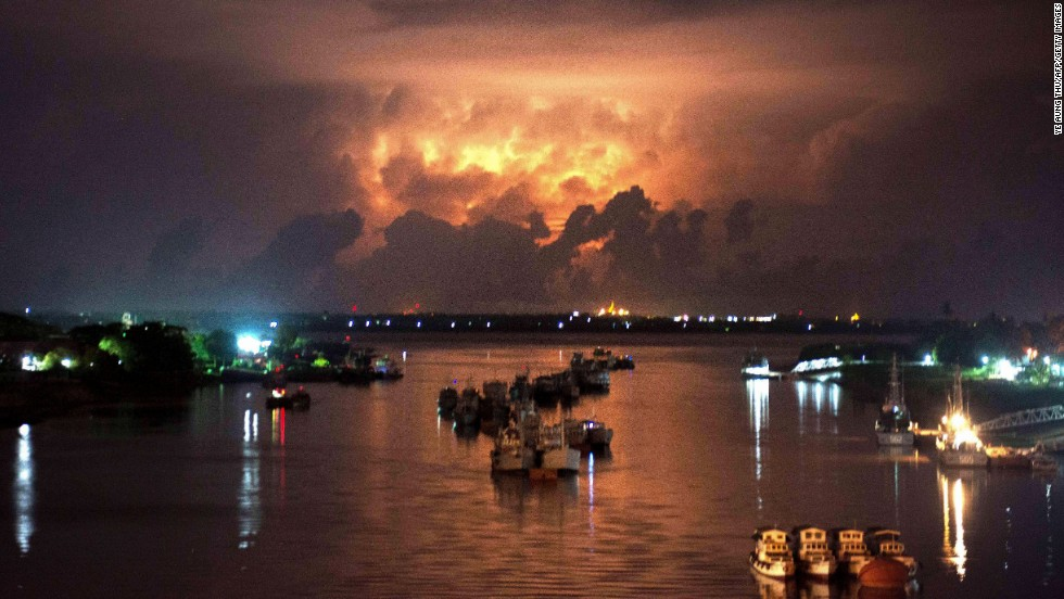 A storm lights up the sky above the Yangon River in Myanmar early on May 13.