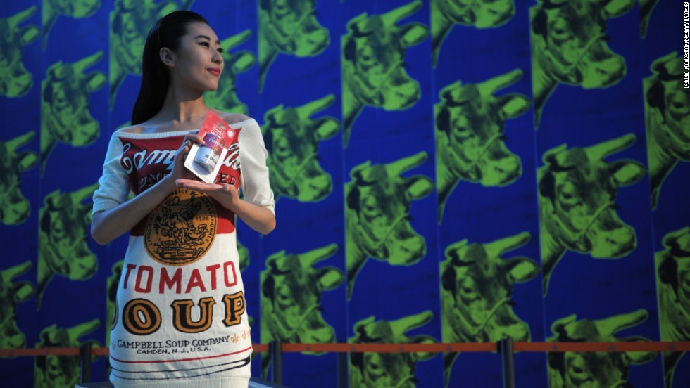 "A model, wearing a Campbell's Soup dress in a nod to Andy Warhol's iconic pop art, stands at the ""Andy Warhol: 15 Minutes Eternal"" exhibition currently showing in Shanghai."
