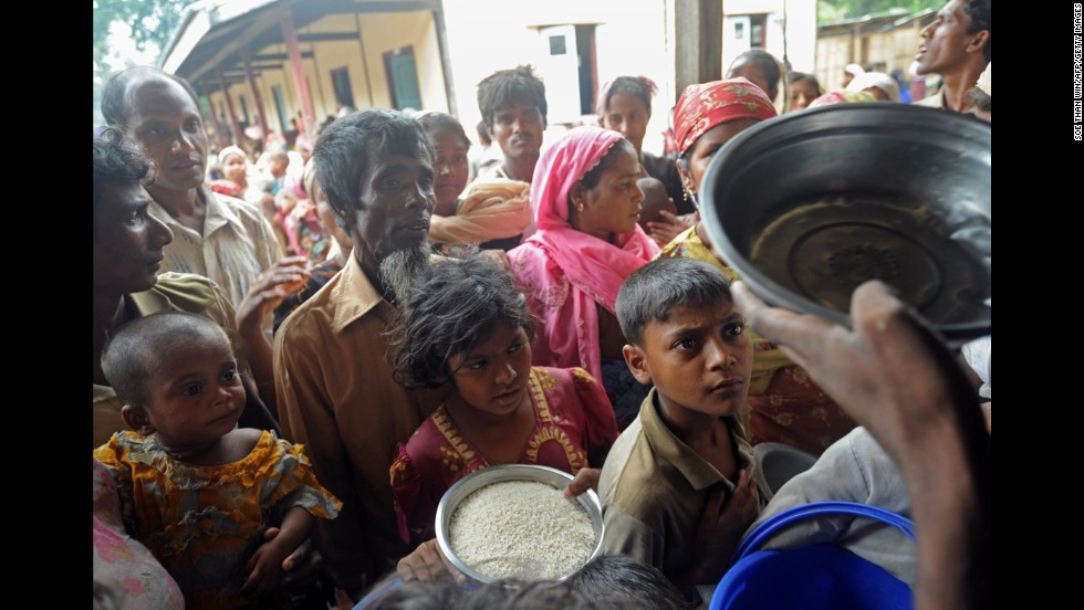 A group of Rohingya families wait for rice supplies at a temporary relief camp near Sittwe on May 16.