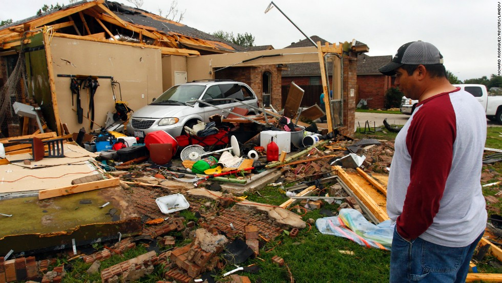 Pete Alaniz eyes damage to the garage of his Cleburne, Texas, rental home on May 16.