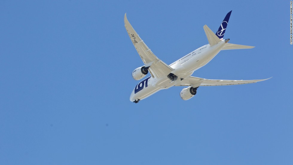 A LOT Polish Airlines 787, with a redesigned lithium-ion battery system, performs a test flight at Paine Field in Everett, Washington. The Dreamliner's distinctive wings sweep back at 32 degrees.