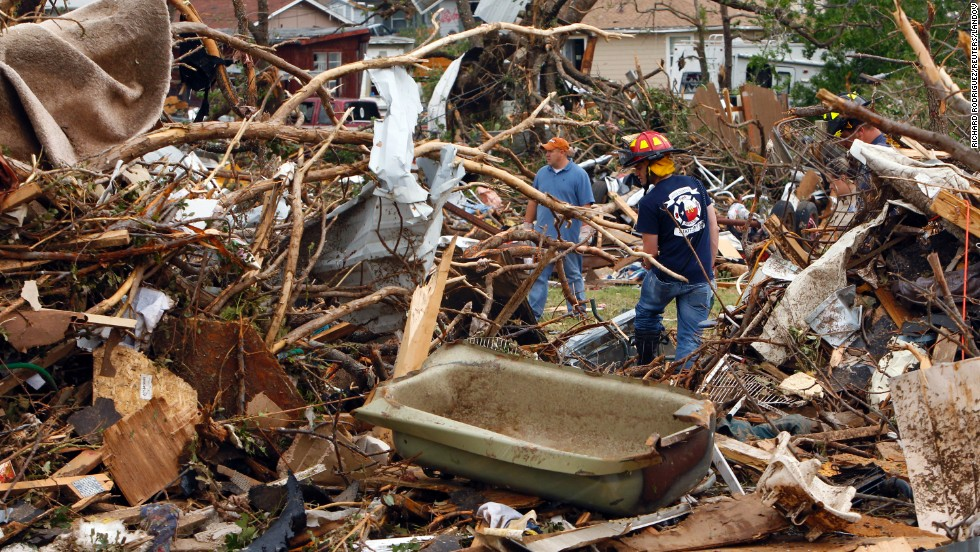 Rescue workers search through debris in Granbury, on May 16.
