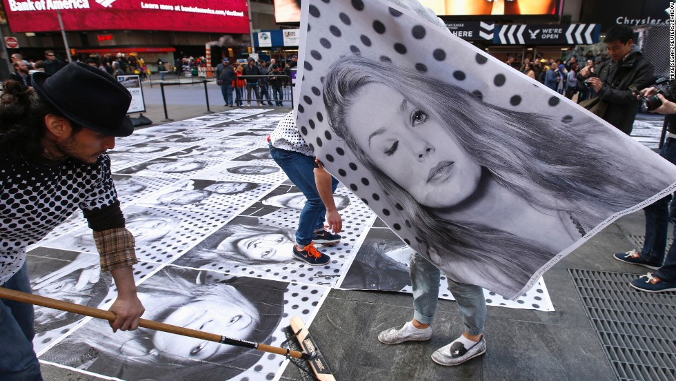 "French street artist JR started <a href=""http://www.insideoutproject.net/en"" target=""_blank"">the Inside Out project</a> in 2011. He invites people around the world to submit portraits, share a statement about what they stand for and paste large-format prints in public spaces. The project has distributed more than 130,000 posters in over 100 countries. Pictured: New York, 2013."