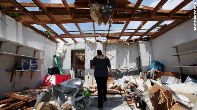 Beth Poledna walks through her garage Thursday, May 16 in Cleburne, Texas, as she begins the clean up process after a tornado destroyed parts of her home.