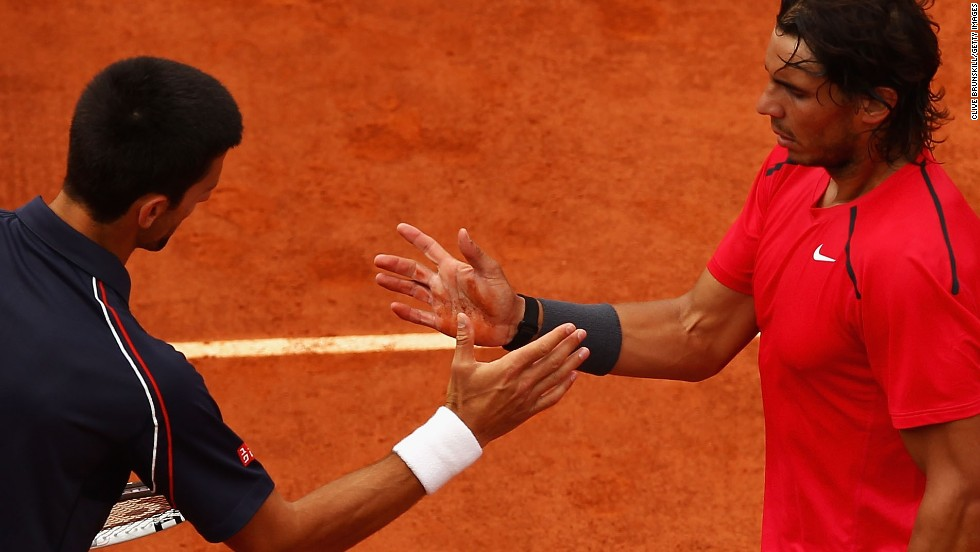 "Novak Djokovic shakes hands with Rafael Nadal after losing to the ""King of Clay"" in the French Open final last year. The Serbian needs to win the title at Roland Garros to join the seven men, Nadal included, who have achieved a career grand slam."