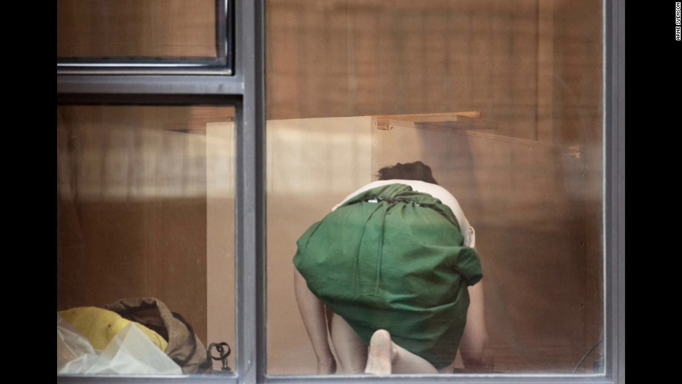 "This photo, ""The Neighbors #5,"" 2012, from photographer Arne Svenson's series, ""The Neighbors,"" is one of several being exhibited at <a href=""http://www.saulgallery.com/"" target=""_blank"">Julie Saul Gallery</a> in New York."