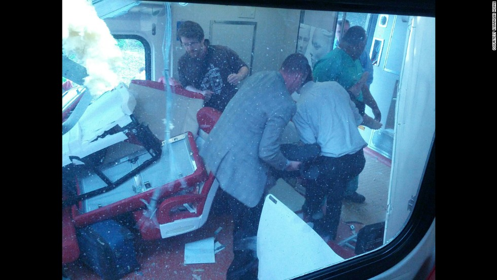 People are seen inside one of the two derailed trains on May 17.