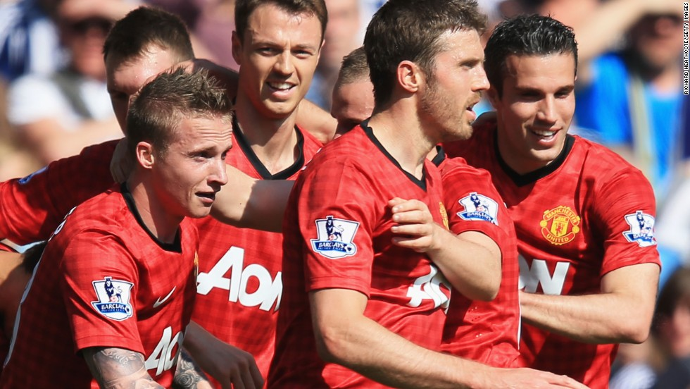 Manchester United's triumphant players celebrate Alexander Buttner's goal to put them 3-0 ahead at the Hawthorns.