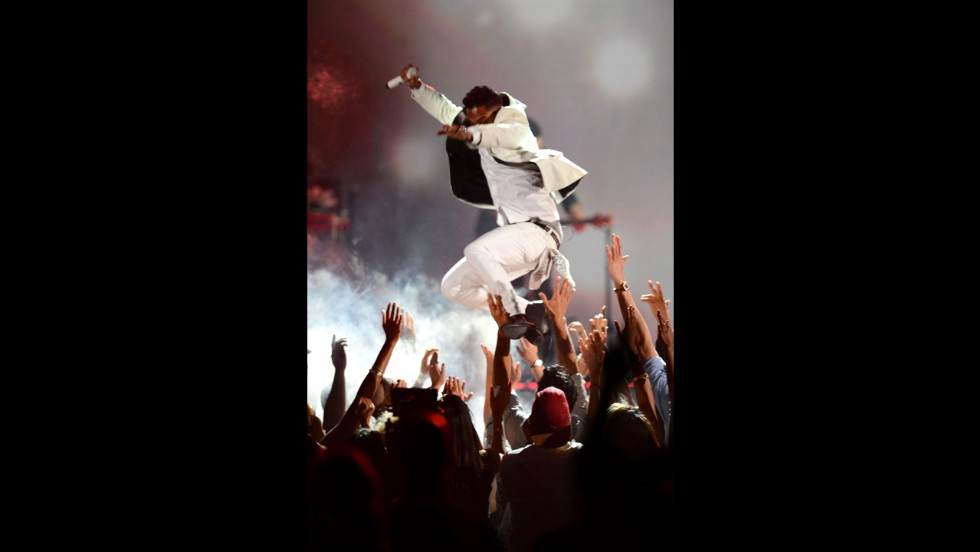 "Miguel performs. <a href=""http://www.cnn.com/video/data/2.0/video/showbiz/2013/05/20/early-miguel-leg-drop.cnn.html"" target=""_blank"">See him accidentally land on a fan after his jump.</a>"