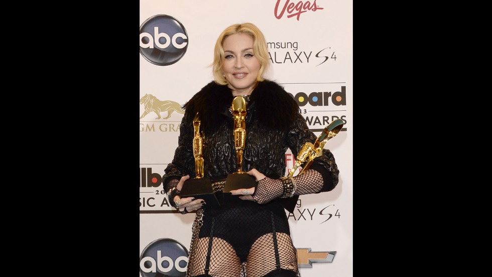 Madonna poses with her awards.