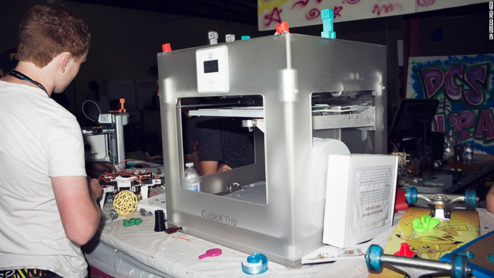 "3-D printers were everywhere at the 2013 Maker Faire. This $3,999 <a href=""http://cubify.com/cubex/"" target=""_blank"">CubeX Trio</a> is printing a small plastic guitar."
