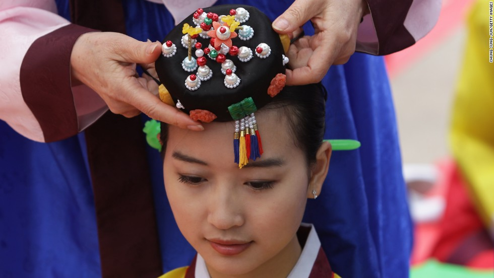 MAY 20 - SEOUL, SOUTH KOREA: Young South Koreans participate in a traditional Confucian coming-of-age ceremony in Seoul. The ceremony celebrates young people who have turned, or are going to turn, 20 this year and is meant to increase their awareness about the responsibilities of adulthood.
