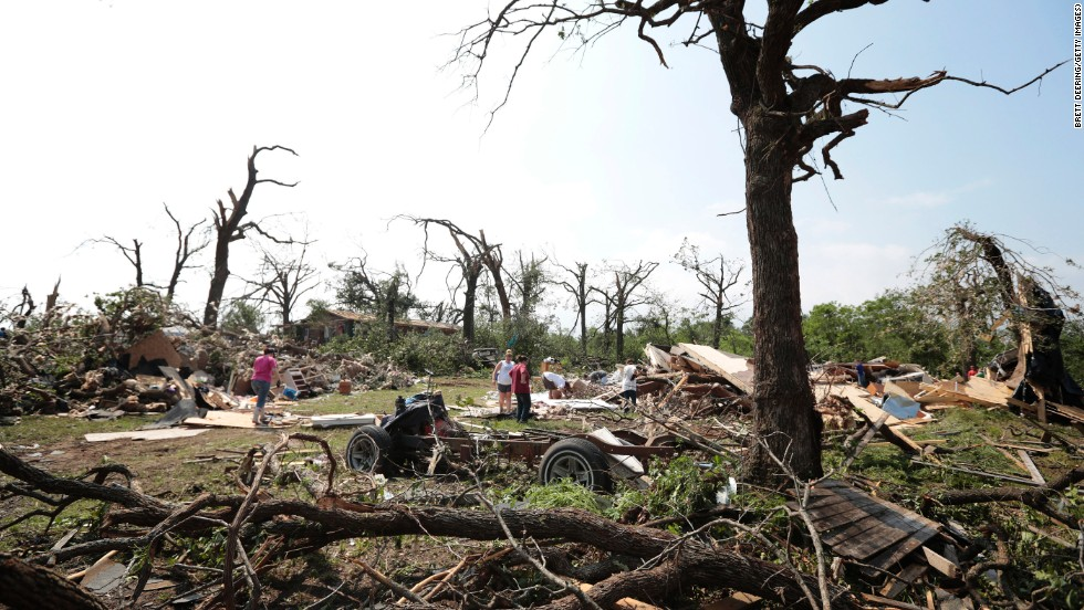 Tom and Ronda Clark get help with cleanup on May 20, after their property near Shawnee was damaged by a tornado on May 19.