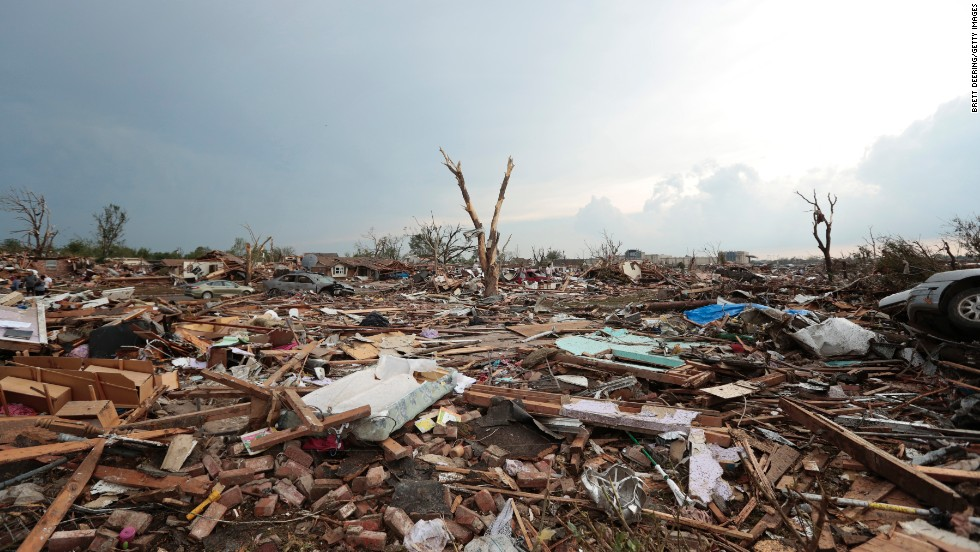 "MAY 21 - MOORE, OKLAHOMA : Debris covers the ground after a powerful <a href=""HTTP://cnn.com/2013/05/21/us/severe-weather/index.html"">tornado ripped through the area </a>on May 20. It tore through a highly populated area, wiping out entire neighborhoods, schools and other buildings."